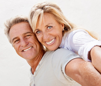 Portrait of a mature couple smiling and embracing.