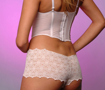 female in lace panties and corset