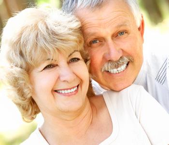 Smiling happy elderly couple in love outdoor