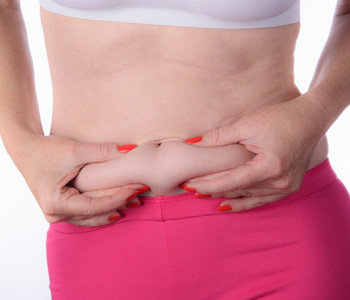 Woman Pinching Belly Fat